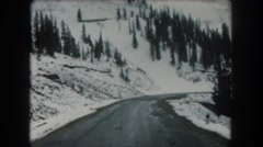 1962: a beautiful snow capped mountain ridge as seen from a moving vehicle Stock Footage