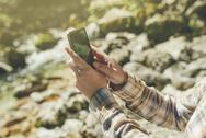 Female tourist using mobile smart phone for GPS navigation Stock Photos