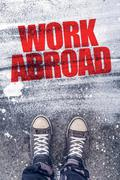 Work abroad title on the pavement Stock Photos