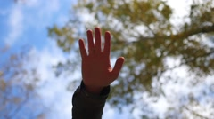 Group of young place their hands together in the center of a circle Stock Footage