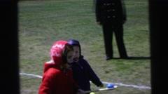 1964: kids taking part in the lemon and spoon reverse walking race CAMDEN Stock Footage