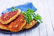 Cutlets on black plate on a table Stock Photos