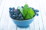 Grape in bowl on a table Stock Photos