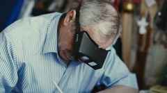 Architect wears magnifying glasses. Magnifying glasses for smaller jobs Stock Footage