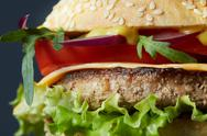 Fresh burger with beef, cheese and tomatoes. Stock Photos