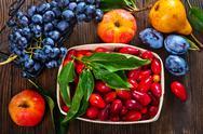 Autumn harvest on the wooden table, autumn fruits Stock Photos