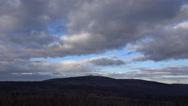 4k Clouds landscape panning mountain range Harz woodland Brocken peak Stock Footage