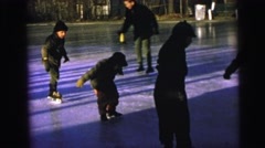 1964: kids are learning ice skating CAMDEN, NEW JERSEY Stock Footage