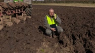 Farmer in middle of the field with a tablet pc Stock Footage