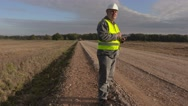 Road construction engineer using tablet on road Stock Footage