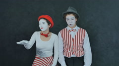 Two young mime dancing Stock Footage