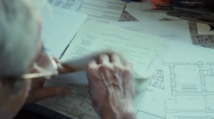 Male architect checking blueprints house construction planning Stock Footage