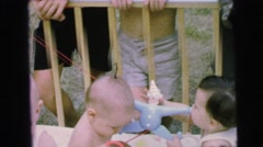 1964: toddlers in cage many trap looking kids CAMDEN, NEW JERSEY Stock Footage
