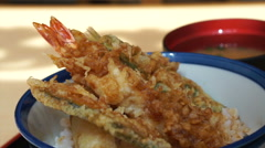 Japanese Fried seafood tempura shrimp, fish, squid and vegetables over rice bowl Stock Footage