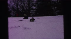 1964: kids are sliding down the hill on the snow CAMDEN, NEW JERSEY Stock Footage