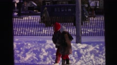 1964: snow and the winter and the children all this together at the same time Stock Footage