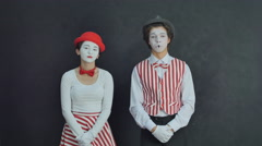Two young mime laugh Stock Footage