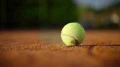 Tennis ball on a clay court. Hot day. Summer season. Close up Stock Footage