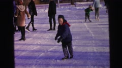 1964: little boy happily ice-skating outdoors CAMDEN, NEW JERSEY Stock Footage