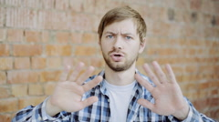 Portrait of Man Trying to Avoid Offer, Dislike, Rejecting Gesture, Disagree Sign Stock Footage
