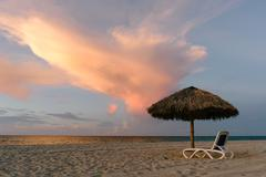 Umbrella on the beach in the sunset hours, Cuba Stock Photos