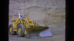 1965: a man operating a large truck or plow on a construction site MEXICO Stock Footage