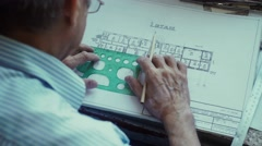 Architect puts a protractor to draw the line and drawing in pencil Stock Footage