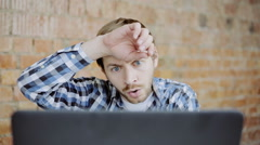 Hard working young man in front of laptop in office. Close-up Stock Footage