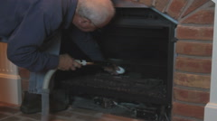 Cleaning and maintaining gas fireplace Stock Footage
