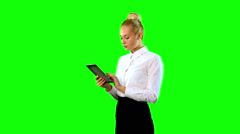 Young Woman with Tablet. Green screen. Middle Sideview Stock Footage