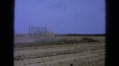 1965: men working in the field making furrows with an adapted machine MEXICO Stock Footage