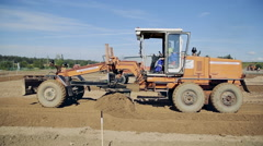 Grader road construction create a flat surface during the grading process Stock Footage