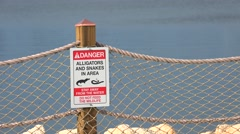 No swimming. Danger. Alligators and snakes in area. Stay away from the water. Stock Footage