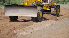 Grader Road Construction Grader industrial machine on construction of new roads Stock Footage