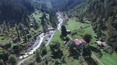 BEAUTIFUL FLY OVER ROCKY RIVER AND HOTEL IN INTERLAKEN SWITZERLAND Stock Footage