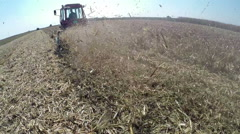 Farmer Using Tractor to Cut Down Corn Stalks Stock Footage