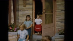 1961: four little girls run outdoor to play in their neighborhood  Stock Footage