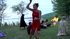 Fire juggler and strange dwarf (slowmotion) Stock Footage