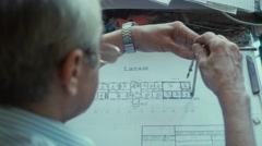Architect applies compasses Drawing and draws a line in pencil Stock Footage