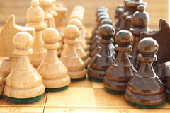Board game chess at wooden chessboard Stock Photos