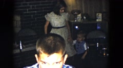 1961: little boy joins his family MICHIGAN Stock Footage