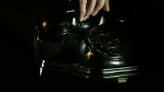 Answering vintage telephone phone call Stock Footage