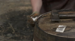 Barrels Whisky hammering on it Stock Footage