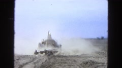 1965: a man on a large machine who appears to be plowing a field MEXICO Stock Footage