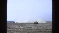 1965: two tractors plowing a field MEXICO Stock Footage