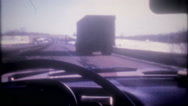Behind the wheel, drive through traffic to New York,3678 vintage film home movie Stock Footage