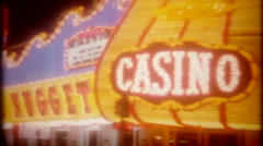 Downtown Las Vegas casino neon at night, 3681 vintage film home movie Stock Footage
