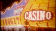 Downtown Las Vegas casino neon at night, 3681 vintage film home movie Stock Footage