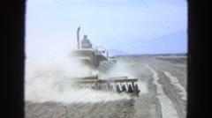 1965: farmer plowing flat dusty field on farm vehicle MEXICO Stock Footage