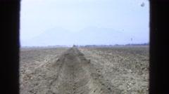 1965: tractor on duty farmland working engine smoky farm MEXICO Stock Footage